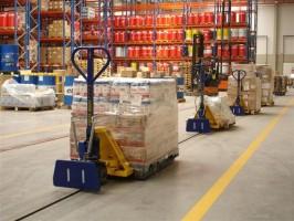 Griekse supermarktketen schaft vloerkettingbaansysteem aan